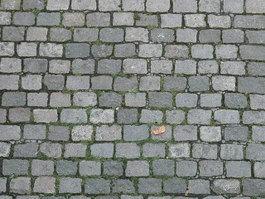Grey interlocking paverment brick texture