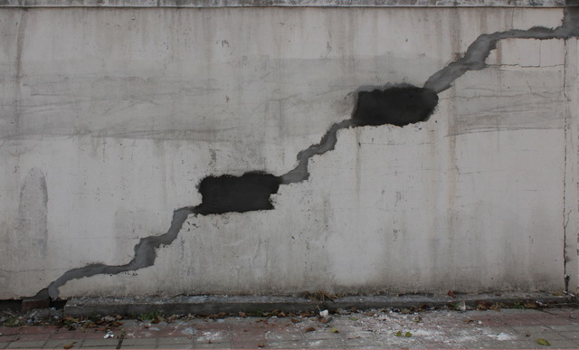 Crack in the whitewashed wall texture
