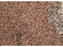 Polished red granite surface texture