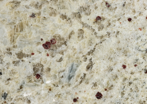 Close Up Of Venetian Gold Granite Slab Surface Texture