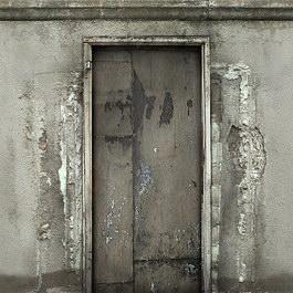 Grungy plaster wall wooden door texture