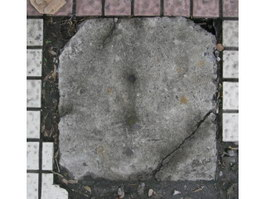 Crack concrete sewer cover and pavement paving texture