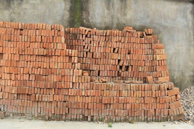 Orderly piles of fire bricks and concrete wall texture