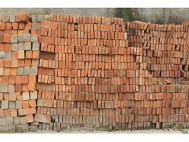 Neatly arranged red clay bricks texture