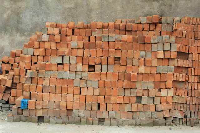 Heap of red bricks texture
