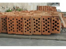 A heap of clay red bricks texture