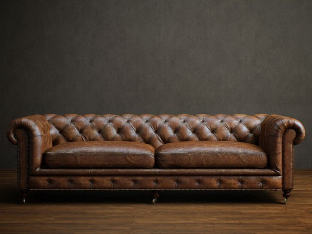 Two seater leather chesterfield sofa 3d rendering