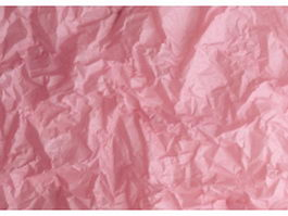 Pink sheet of crumpled paper texture